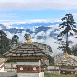 stupas on the way to punakha with the Himalayas in the background