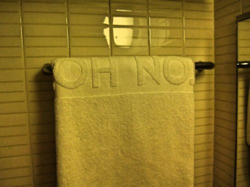 "Hotel towel that says ""oh no"""