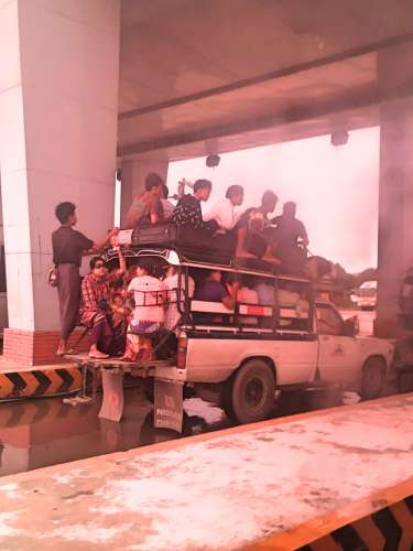 A truck overloaded with passengers on the way to Kalaw