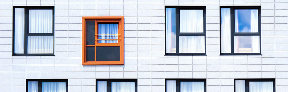 photo of windows, all black with one red.