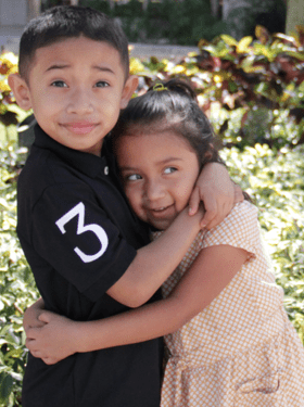 Julian and Sister - 7-year-old Homestead boy looks for a Match at Calle Ocho Festival