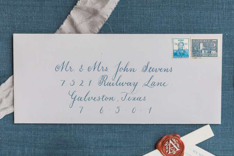 Formal Copperplate Calligraphy Envelopes - Centered by CalliRosa Calligrapher in San Antonio Texas - grey envelope with navy lettering