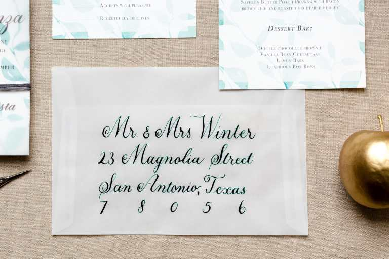 Formal Copperplate Calligraphy Envelopes - Centered by CalliRosa Calligrapher in San Antonio Texas - vellum envelope with dark green lettering