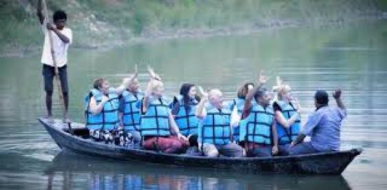Tourists are enjoying the canoe ride.
