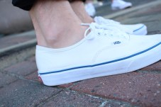 White Classic low-cut vans.