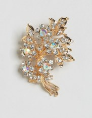 Broche feuille ornée de sequins, New Look, 7 euros