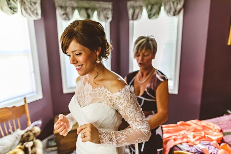mother helping bride before wedding