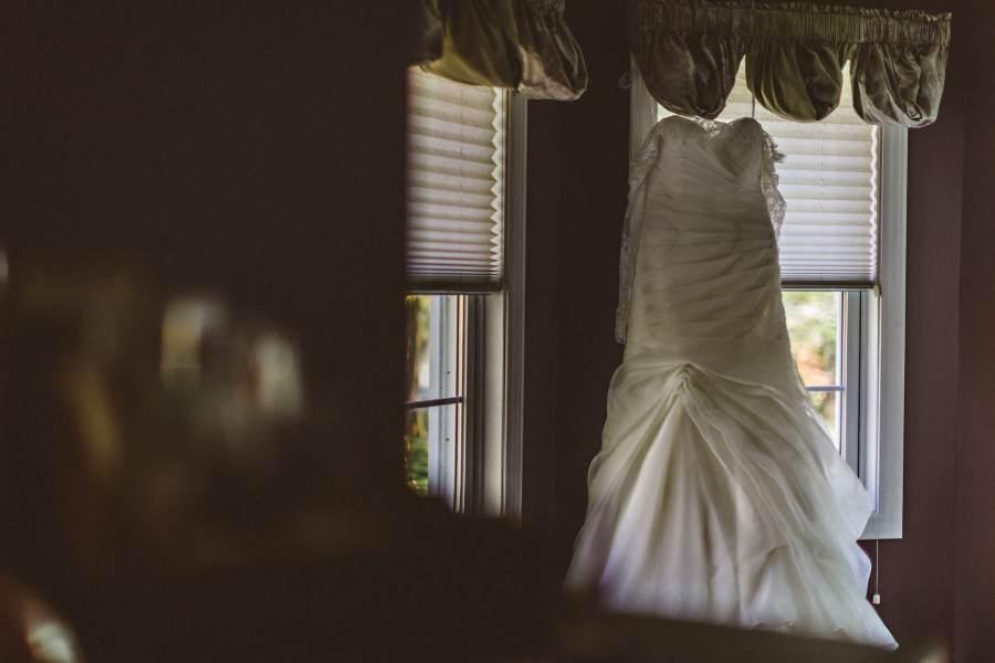 dress hanging at windows