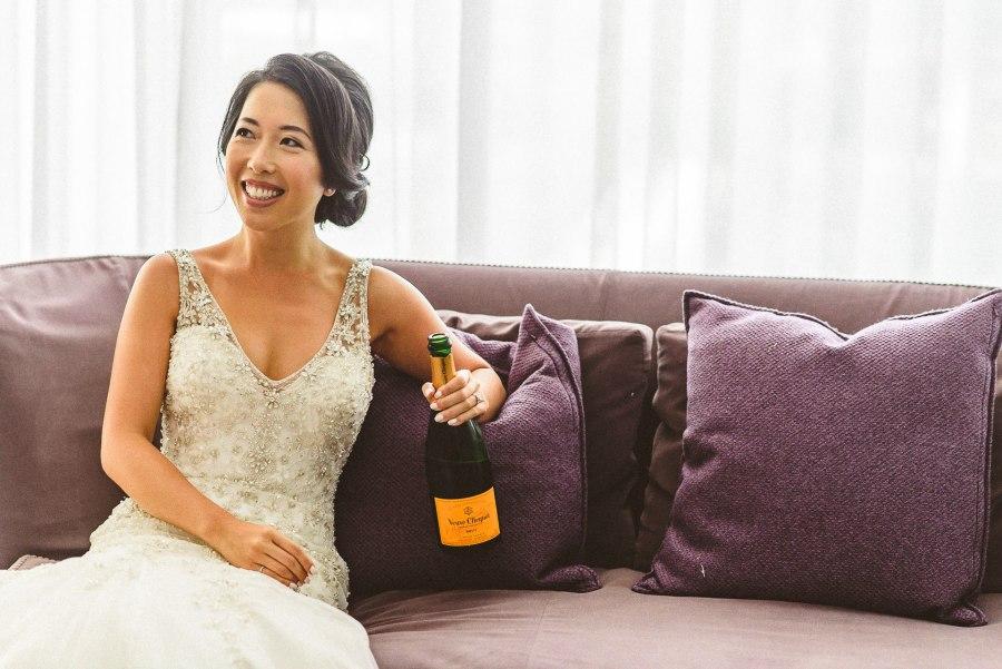 Bride drinking champagne at Thompson Hotel Wedding