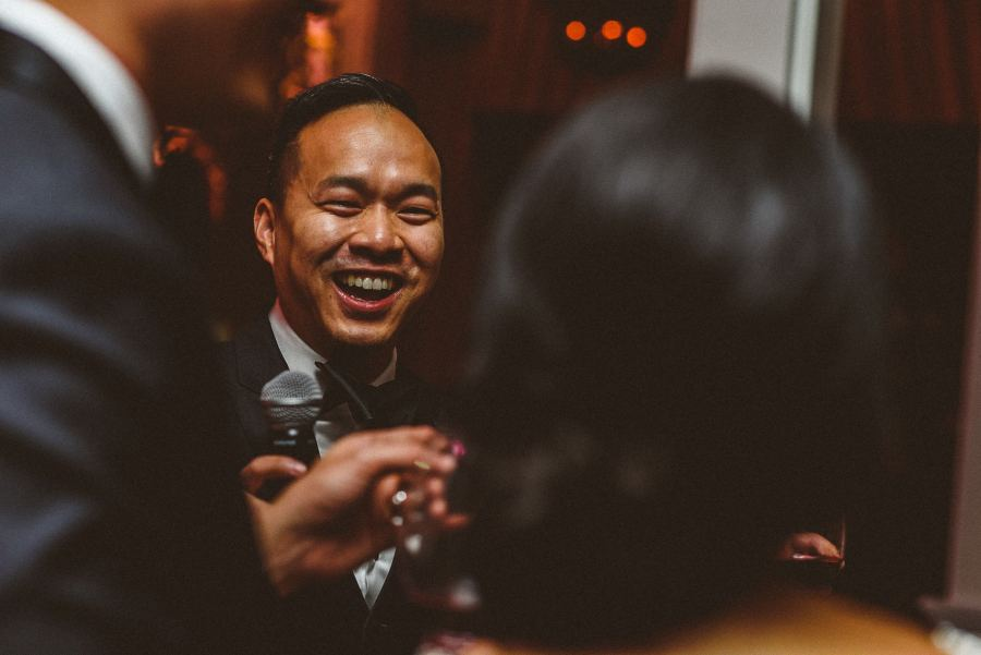 Laughing brother at reception