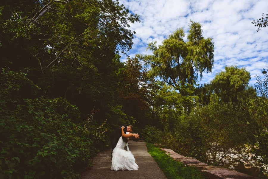 Groom dipping Bride at Edwards Gardens