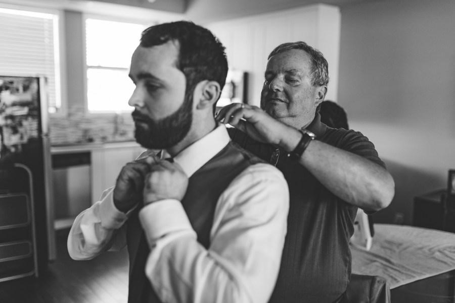 dad helping groom
