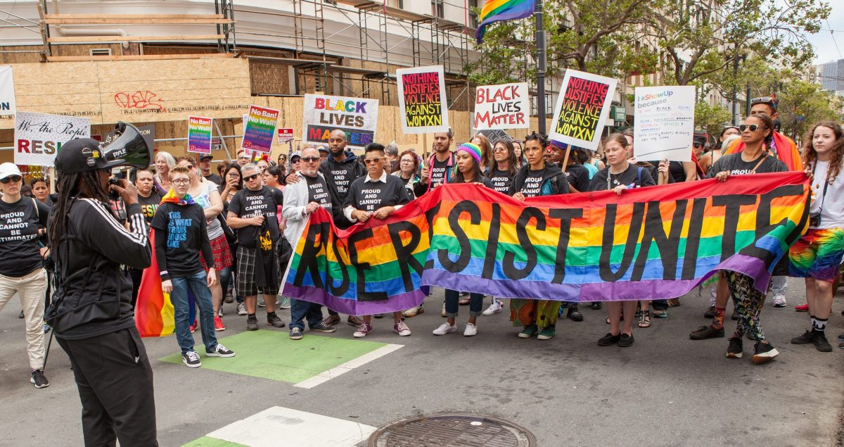 """""""Rise Resist Unite"""" read one banner on display at San Francisco's first Pride parade after Trump's election. Photo by Pax Ahimsa Gethen via Wikimedia"""