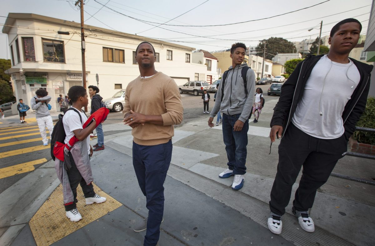 Principal Charleston Brown oversees dismissal at Willie L. Brown Jr. Middle School in San Francisco's Bayview neighborhood. His black students struggle to pass state tests in reading and math. Penni Gladstone / For CALmatters