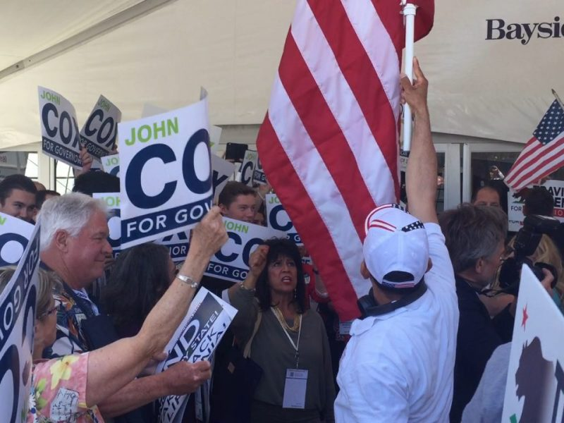 Supporters of gubernatorial primary candidates John Cox and Travis Allen at the California Republican Party's convention in May. Photo by Ben Christopher/CALmatters