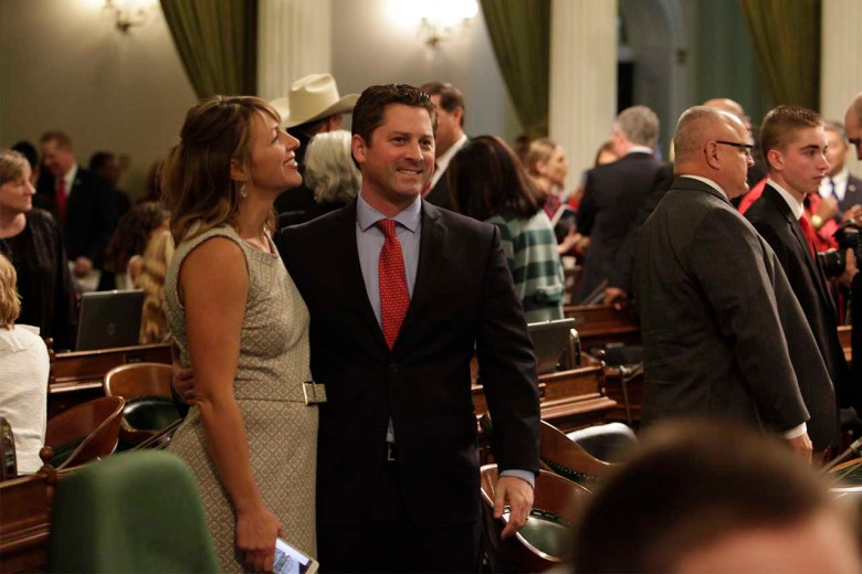 Jordan Cunningham stands smiling on the Assembly floor.