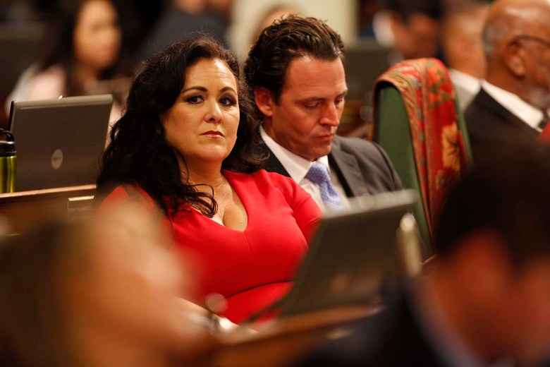 Lorena Gonzalez looks on while sitting at her desk in the Assembly chamber.