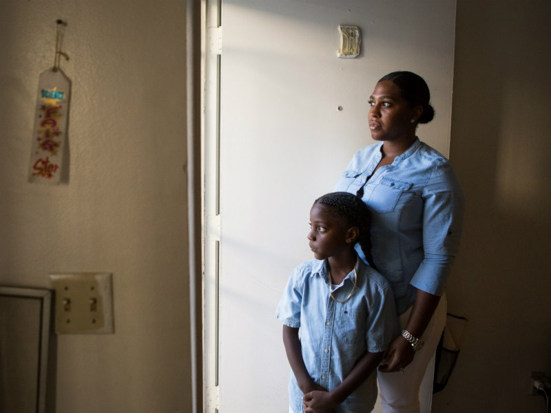 Keshara Shaw poses with her son, Mikahi, at their Los Angeles apartment. She wants interdistrict transfers in California to help move her son to another school district out of safety concerns.