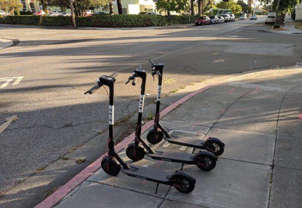 Bird scooters on the sidewalk in San Jose.