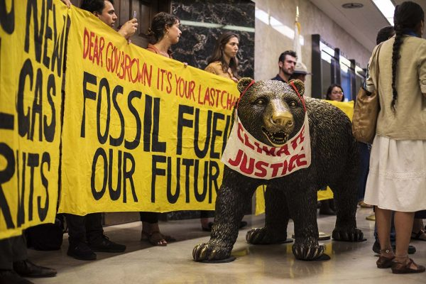 Anti-oil demonstrators in front of Gov. Jerry Brown's Capitol office. | Photo by Robbie Short/CALmatters