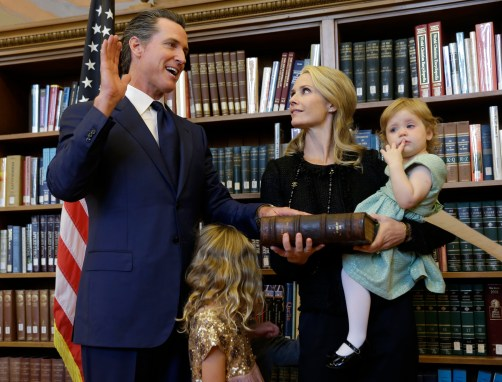 Lt. Gov. Gavin Newsom takes the oath of office in 2015, pictured with his wife, Jennifer Siebel, and one of their four children. Photo by Rich Pedroncelli, Associated Press