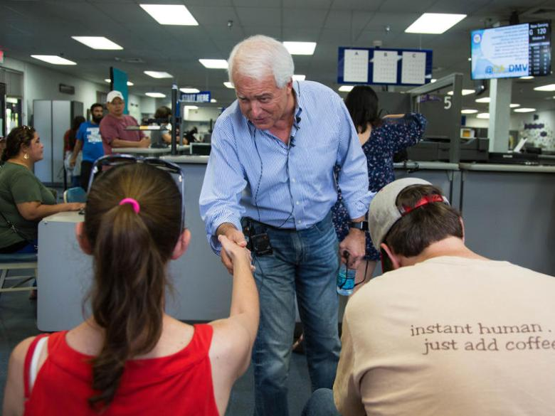 John Cox, GOP candidate for governor, greets DMV clients in Sacramento to draw attention to the agency's long wait times. Photo by Andrew Nixon / Capital Public Radio