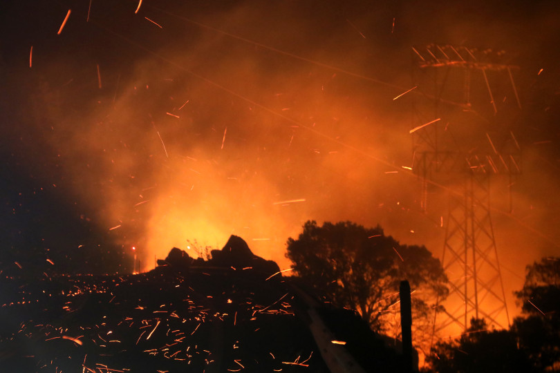 BUTTE COUNTY, CALIFORNIA - NOVEMBER 11: Heavy overnight winds push embers from the Camp Fire up Highway 70 west of Pulga, Calif. early Sunday morning, November 11, 2018. (Karl Mondon/Bay Area News Group)