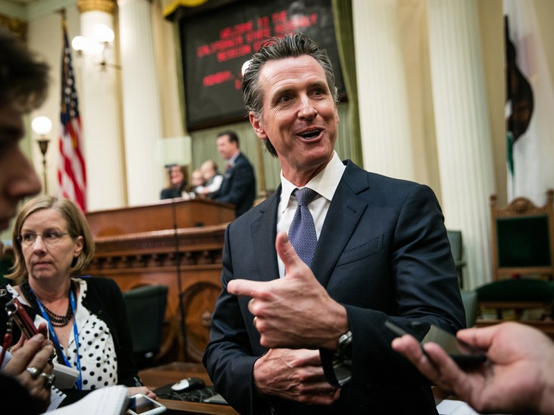 Governor-elect Gavin Newsom speaks to reporters on the floor of the Assembly chambers on December 3, 2018 at the State Capitol in Sacramento, California.