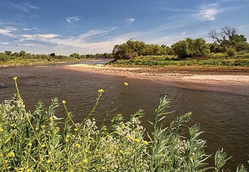 View of theView of the Tuolumne River as it approaches the confluence with the San Joaquin. Dos Rios Ranch, with more than six miles of river frontage, is among sites in which floodplains are being restored. Photo via River Partners River as it approaches the confluence with the San Joaquin. Dos Rios Ranch has more than six miles of river frontage. Photo via River Partners