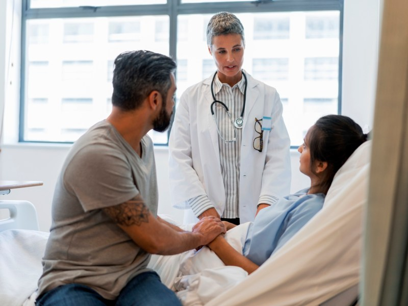 image of doctor explaining couple in hospital
