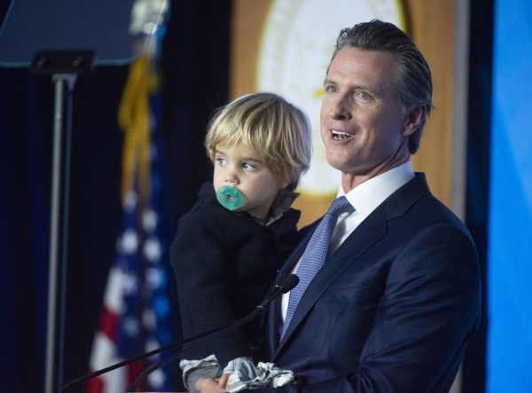 Gavin Newsom holds his son Dutch, 2, after he was sworn in as the 40th Governor of California on the west steps of the State Capitol on Monday, January 7, 2019 in Sacramento, California.