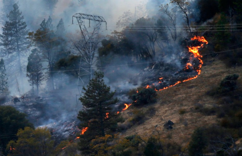 PULGA, CALIFORNIA - NOVEMBER 12: Fire burns around PG&E transmission towers, Monday, November 12, 2018, east of Pulga,Calif. The first report of the deadly Camp Fire was made near here. (Karl Mondon/Bay Area News Group)