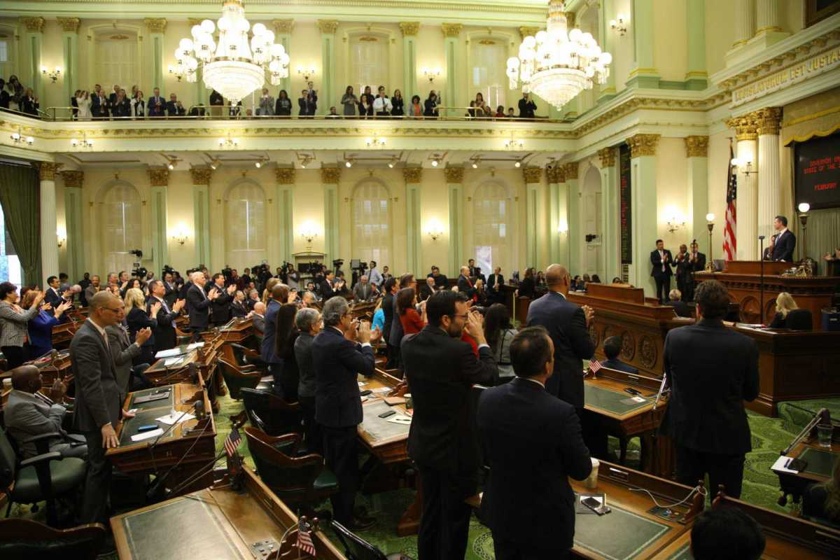 California legislators applaud Gov. Gavin Newsom as he delivers his first State of the State speech. Photo by Andrew Nixon, Capital Public Radio
