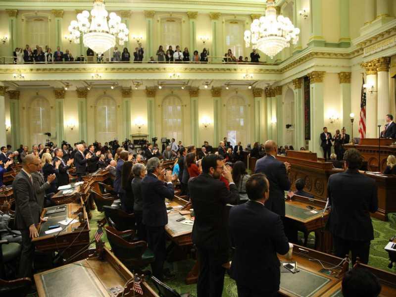 California legislators applaud Gov. Gavin Newsom as he delivers his first State of the State speech. Photo by Andrew Nixon, Capital Public Radio