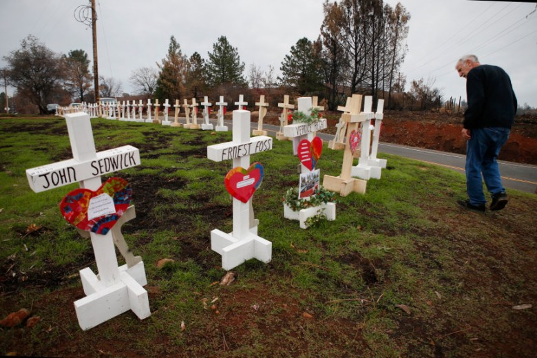 Steve Boese looks for the name of his neighbor among the 86 crosses of Camp Fire victims erected in Paradise. Photo by Karl Mondon/Bay Area News Group.