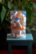 A jar holds the many medications prescribed for Elizabeth Brown. Photo by Penni Gladstone for CALmatters