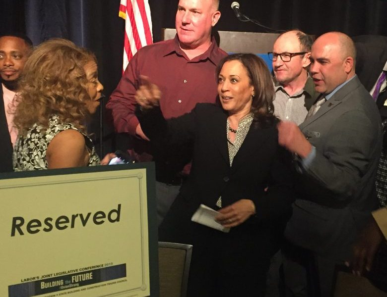 Democratic Sen. Kamala Harris points off camera as she greets members of organized labor at a conference in downtown Sacramento, April 1, 2019.