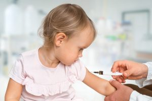 photo illustration of a child receiving a shot