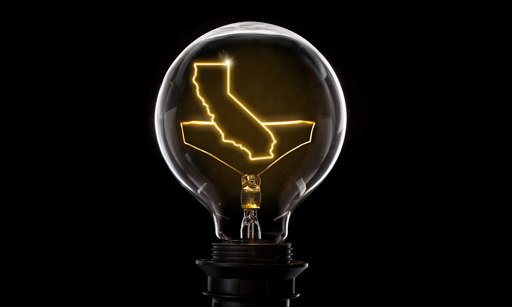 Lightbulb with a glowing wire in the shape of California (series)