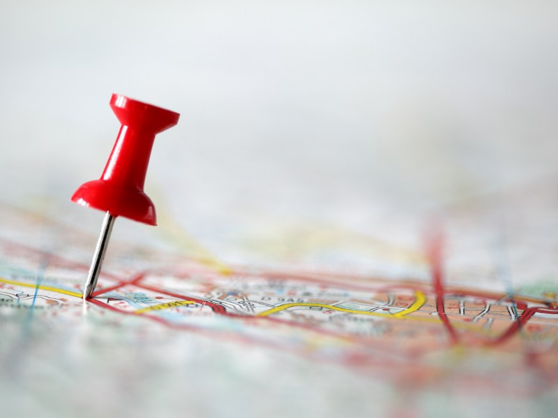 Red pushpin showing the location of a destination point on a map. California: Legislators are considering two bills that would place new districting rules on local governments.