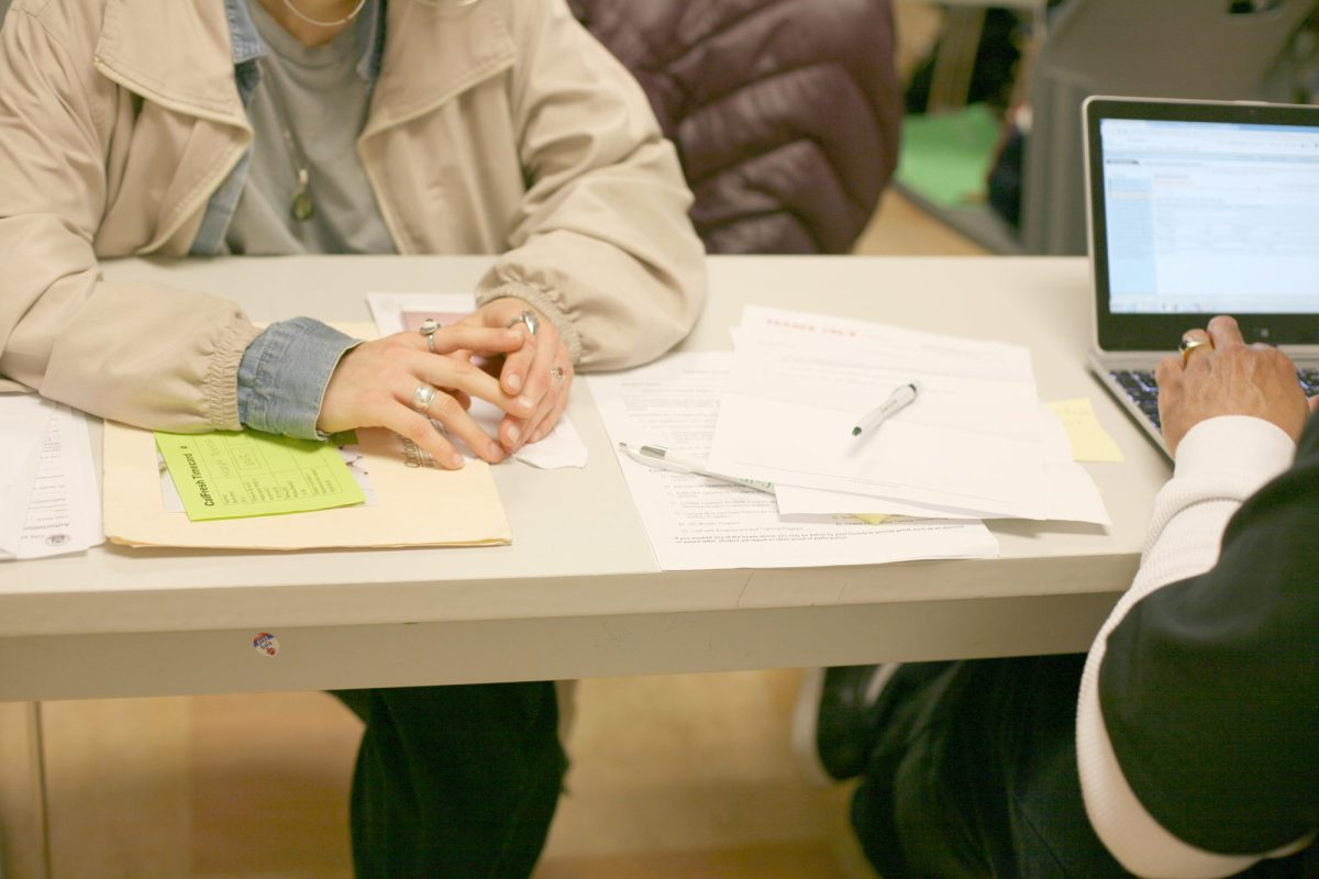 A Bay Area woman fills out paperwork to show she is eligible for CalFresh, California's food stamp program.