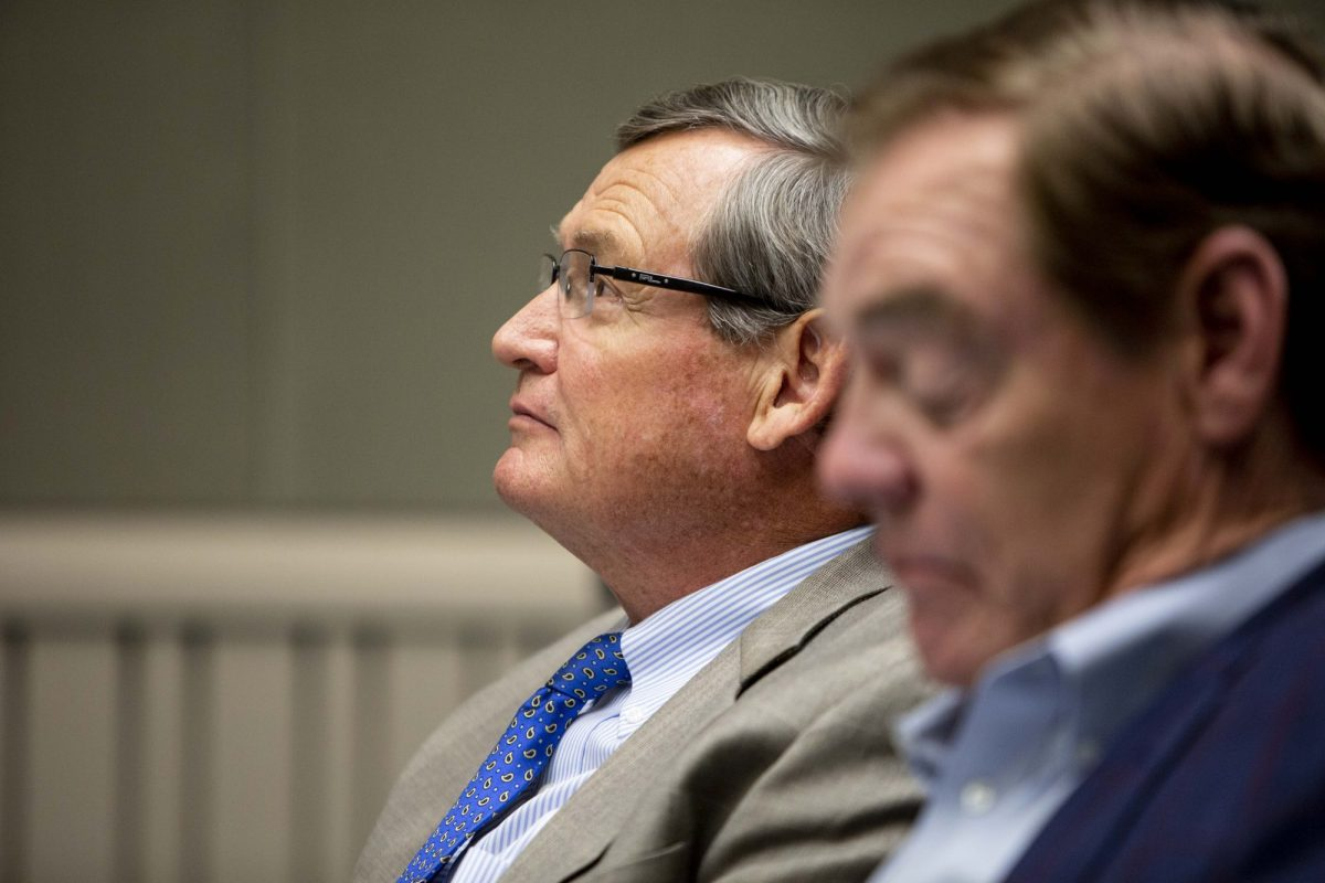 Timothy P. White, Chancellor of the California State University system, left, prepares to testify on the failure to fully disclose a $1.5 billion surplus in a joint hearing of the Joint Legislative Audit, Senate Education, Assembly Higher Education and Assembly subcommittee on Education Finance committees on August 12, 2019. Photo by Anne Wernikoff for CalMatters