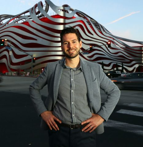 Michael Bodell, deputy director of the Petersen Automotive Museum, stands in front of the museum, which is in Los Angeles. Photo by Iris Schneider for CalMatters