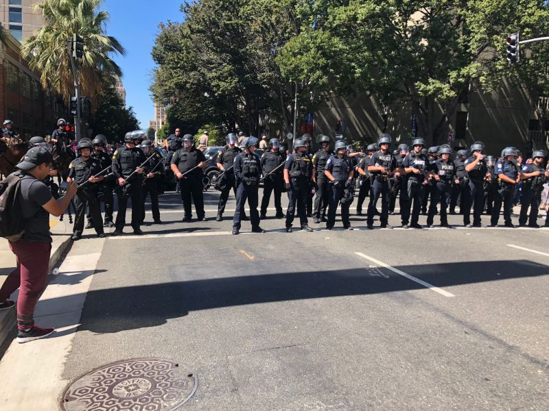 Police standing outside protests against Stephon Clark's shooting death in Sacramento, California. September 18, 2018. Photo by Byrhonda Lyons for CalMatters.
