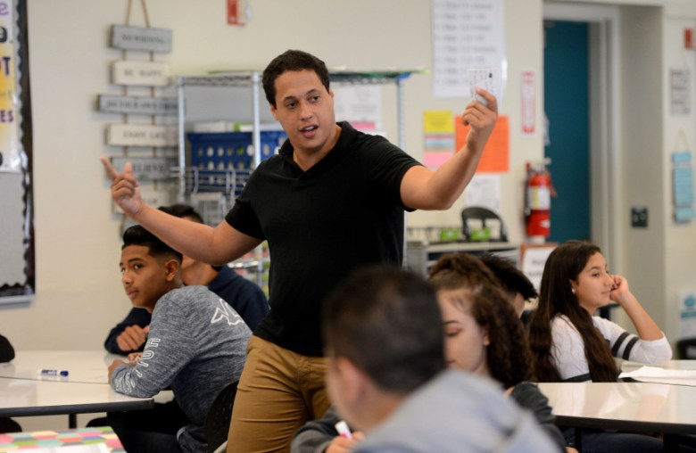 Christopher Rogers talks to students in a Biology/Literature class at James Lick High School in San Jose, Calif., on Wednesday, Aug. 9, 2017. Rogers is teaching under a emergency credential as he completes his multi-subject credential program through Loyola Marymount University. Due to teacher shortages, some schools are hiring teachers with emergency credentials to fill positions on their teaching staffs. (Dan Honda/Bay Area News Group)