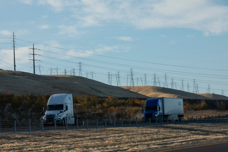 Trucks drive past power lines along I-5 outside of Patterson.