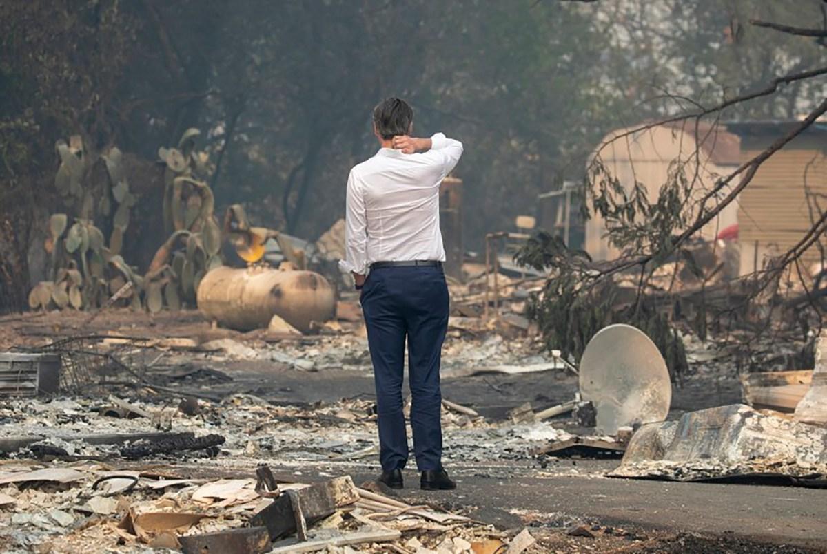 Gov. Gavin Newsom surveys a home destroyed in the Kincade Fire