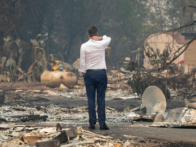 Gov. Gavin Newsom surveys a home destroyed in the Kincade Fire