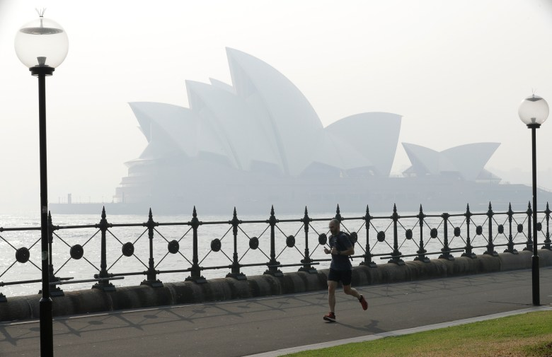 Wildfire smoke casts a pall over the Sydney Opera House. AP photo by Rick Rycroft