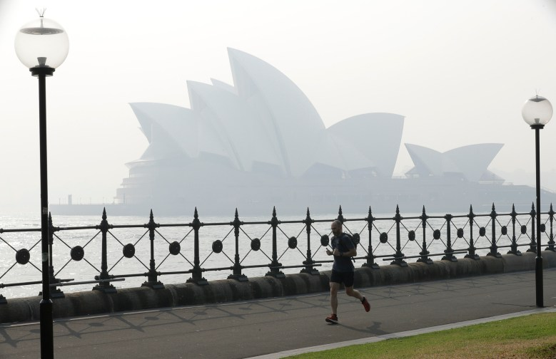 Wildfire smoke casts a pall over the Sydney Opera House. AP photo by Rick Rycroft